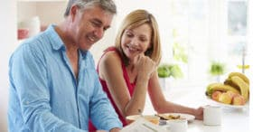 : Man and woman discussing when to sign up for Medicare