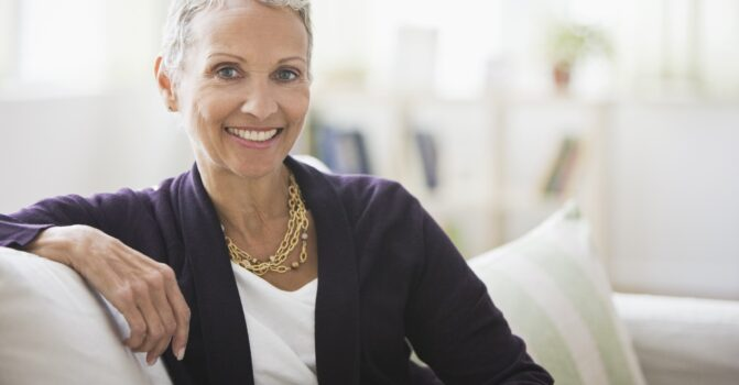 Senior woman smiling on a couch