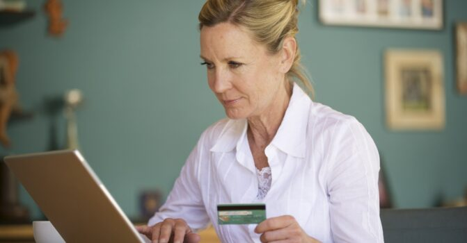 Woman paying her Medicare expenses online