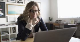 Middle aged woman researching Medicare Advantage plans